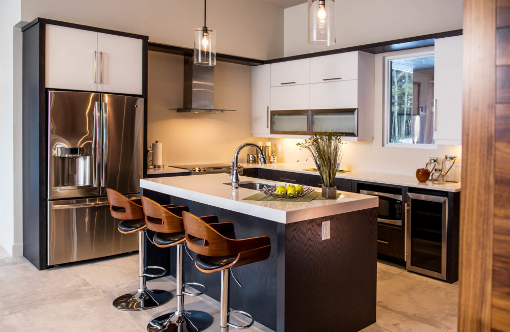 Beautiful modern kitchen in a dark charcoal stained oak and glossy white thermoform. Kitchen from Wildwood Cabinet.