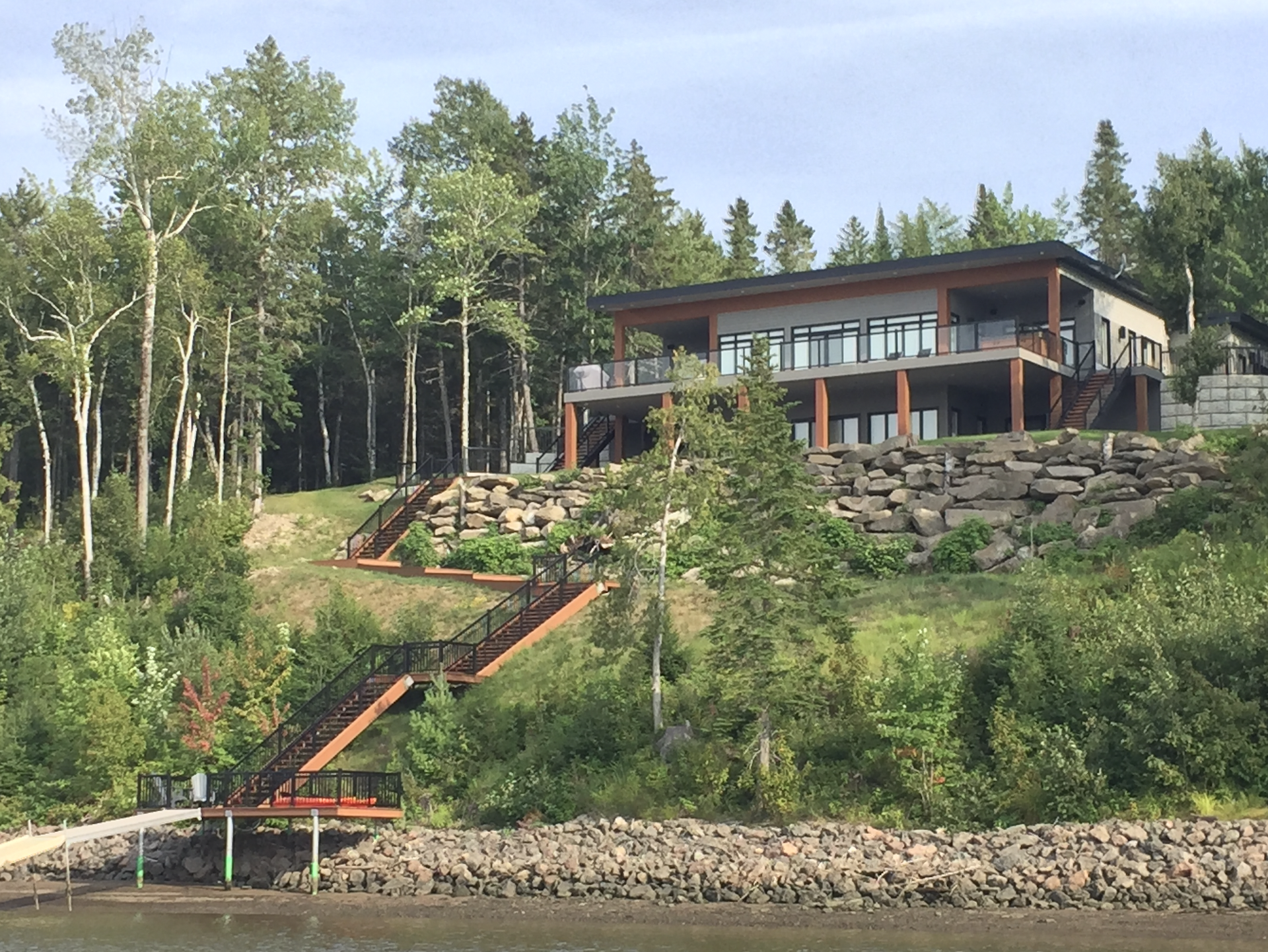 Riverside Retreat: View from the river in the summer